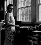Leona White Cooking in Kitchen by George Fox University Archives