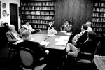 Group of administrators discuss around table by George Fox University Archives