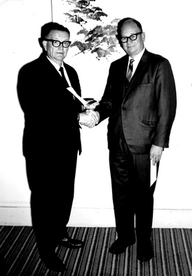 Dr. Milo Ross (left) accepts Southern Pacific gift of $3,250 from A.T. Carlston, District Freight & Passenger Agent in Portland (Oct. 1968)