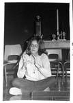 Student, female in glasses playing cat's cradle