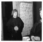 Two Men in Black Robes Wait Backstage