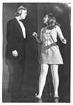 Female Shows Man in Black Tuxedo a Dance