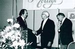 Gene Hockett shakes hand of Glenn Reinard