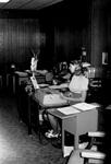 Staff member works at desk
