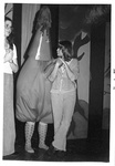 Females stand next to person in strange puffy outfit