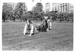 Three students play frog hop while in costume
