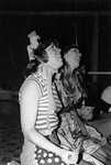 Two females in costume smile and look up to something out of shot by George Fox University Archives