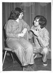 Two students in pajama costumes have delightful conversation