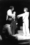 Actor holds arms straight out, looking at another actor by George Fox University Archives