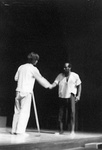 Actor shakes hand with another man by George Fox University Archives
