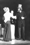 Woman shakes hands with man in top hat