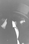 Close up side view of man in top hat