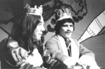 Close up of two actors sitting and smiling by George Fox University Archives