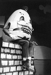 Humpty Dumpty sits on the brick wall