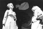 Alice stands next to actress in white dress by George Fox University Archives