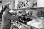 Bill Loewen replaces sweatshirts in the bookstore