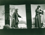 Male and female actors perform on stage