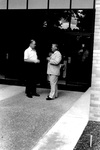 Bill Green and David LeShana speak outside building by George Fox University Archives