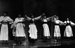 Female actresses perform dance on stage by George Fox University Archives