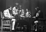 Actors perform at dinner table in play by George Fox University Archives