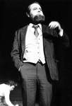 Actor with beard performs in front by George Fox University Archives
