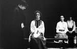 Female actresses sit on benches; one actress paces by George Fox University Archives