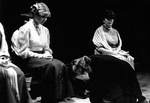 Actresses sit while male actor cries on floor by George Fox University Archives