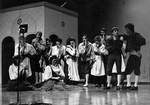 Cast members perform in play by George Fox University Archives