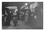 People gather in lobby before a performance by George Fox University Archives