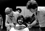 Jeannette McNichols cutting beard of man by George Fox University Archives