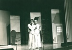 Two men perform an act on stage by George Fox University Archives