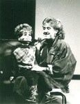 Woman performs ventriloquism by George Fox University Archives