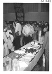 People getting food at Alumni Reception by George Fox University Archives