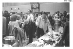 Man getting food at Alumni Reception by George Fox University Archives