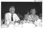 People Sitting at a Table at an Alumni Reception by George Fox University Archives
