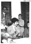Man Presenting a Plaque at an Alumni Reception by George Fox University Archives