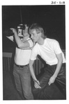 Man Filming at the Alumni Talent Show in 1983 by George Fox University Archives