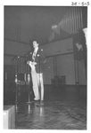 Man Speaking Onstage at the Alumni Talent Show in 1983 by George Fox University Archives
