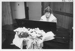 Woman Playing the Piano at the Secretary's Luncheon by George Fox University Archives