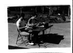 Students on Typewriters outdoors
