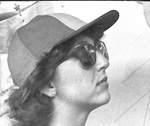 Woman in Baseball Hat