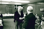 Roy Hiebert receiving from Don Millage