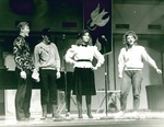 Four students perform on stage
