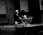 Actor performs with baby is bassinet