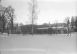 Murdock Learning Resource Center covered in Snow by George Fox University Archives