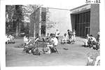 Students playing music in front of the Library by George Fox University Archives