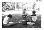 Students Studying in the Grass by George Fox University Archives