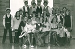 Cast of performance poses for group photo by George Fox University Archives