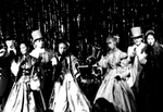 Group of students sing in costume by George Fox University Archives
