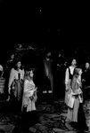 Cast members stand around stage and sing by George Fox University Archives